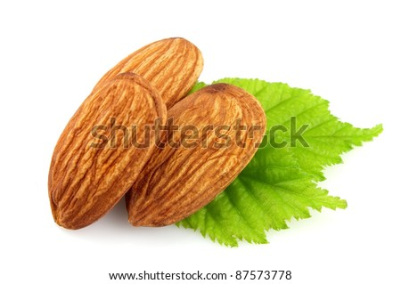 Grains of almonds with a leaf - stock photo
