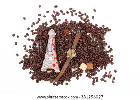 Grains of coffee with a French biscuits and a clock - stock photo