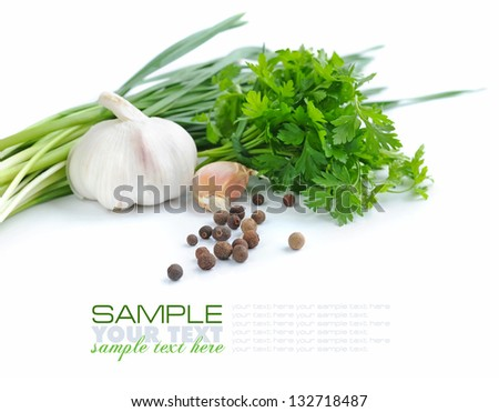 Grains of pepper are with a garlic and greenery of parsley on a white background - stock photo