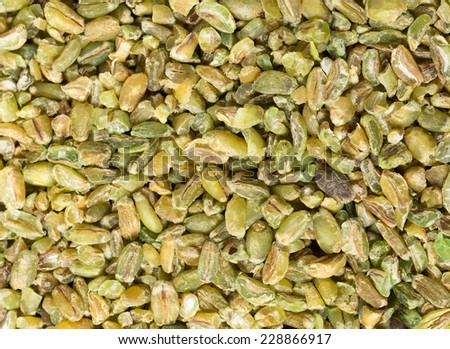 Grains of uncooked freekeh, an old Middle Eastern cereal made by fire-roasting immature wheat grains. The cereal has a very low glycemic index and is high in protein, fibre and minerals - stock photo