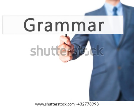 Grammar - Businessman hand holding sign. Business, technology, internet concept. Stock Photo - stock photo