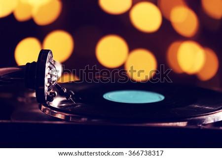 Gramophone on bright blurred background - stock photo