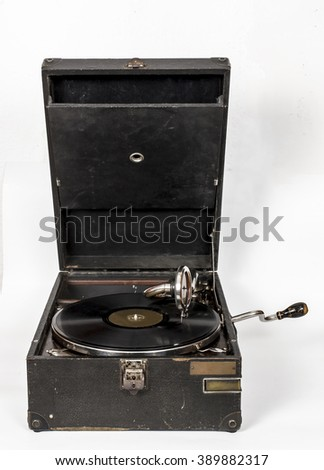 Gramophone with a vinyl record  isolated over white background - stock photo