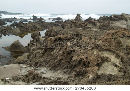 Gran Canaria, north west coast at Banaderos area, old lava field and tide pools - stock photo