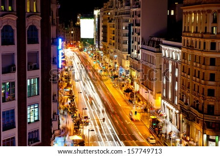 Gran via street in Madrid - Spain capital at night with blurred car lights. - stock photo