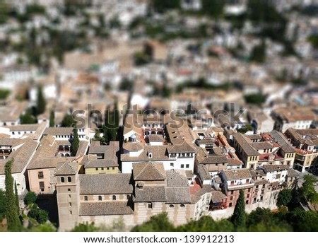 Granada - historic and picturesque Andalusian white town. TILT SHIFT photo. - stock photo