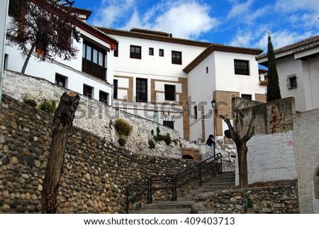GRANADA, SPAIN - April 12, 2106: The Albaicin became a UNESCO World Heritige site in 1994.  - stock photo