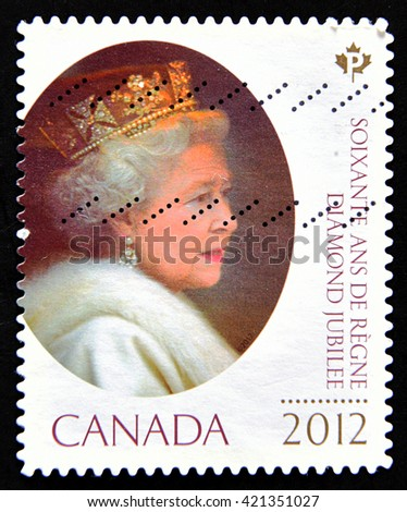 GRANADA, SPAIN - MAY 15, 2016: A stamp printed in Canada shows queen Elizabeth II, Diamond Jubilee, circa 2012 - stock photo