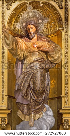 GRANADA, SPAIN - MAY 29, 2015: The carved and polychrome statue of The Heard of Jesus  in church Real Colegiata de San Hipolito by Sanchez Castinez drom 19. cent. - stock photo
