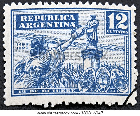 GRANADA, SPAIN - NOVEMBER 30, 2015: A stamp printed in Argentina shows woman holding wreath against of statue of famous person, 1929 - stock photo
