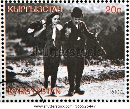 "GRANADA, SPAIN - OCTOBER 19, 2015: A stamp printed in Kyrgyzstan shows Paulette Goddard and Charles Chaplin in the movie ""Modern Times"", circa 2000 - stock photo"