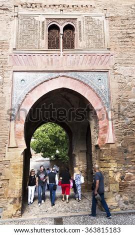 GRANADA, SPAIN - SEPTEMBER 8, 2015: Crossing the Wine Gate from and to the Alcazaba, Alhambra, on September 8, 2015, in Granada, Spain - stock photo