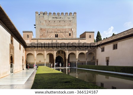GRANADA, SPAIN - SEPTEMBER 8 2015: View of the north portico of the Court of the Myrtles with tourists admiring the fabulous art work, in The Alhambra, on September 8, 2015, in Granada, Spain - stock photo