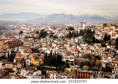 Granada with Sierra Nevada in the back. Views from Alhambra. (Spain) - stock photo