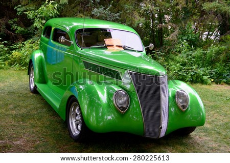 GRANBY QUEBEC CANADA JULY 29 2013: 1937 Ford Sedan line of cars was updated in 1937 with one major change  the introduction of an entry-level 136 CID (2.2 L) V8 in addition to the popular  flathead V8 - stock photo