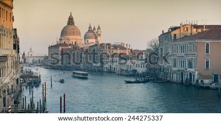 Grand Canal and Basilica Santa Maria della Salute during sunset, Venice, Italy - stock photo