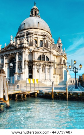 Grand Canal and Basilica Santa Maria della Salute in Venice on a bright day. This image is toned. - stock photo