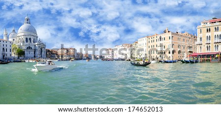 Grand Canal and Basilica Santa Maria della Salute with blue sky - stock photo