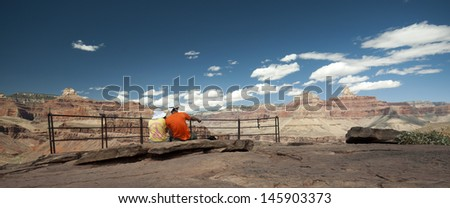 Grand Canyon hiker couple resting at Plateau View Point - stock photo