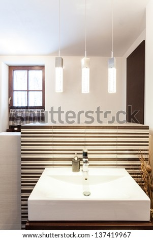 Grand design - closeup of modern rectangular vessel sink - stock photo
