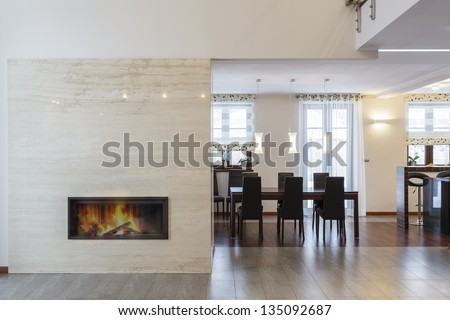Grand design - Fireplace in living room and table - stock photo