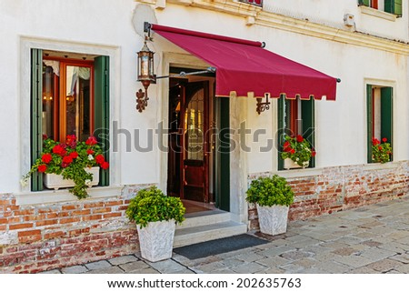 grand entrance in a typical hotel in Venice Italy - stock photo