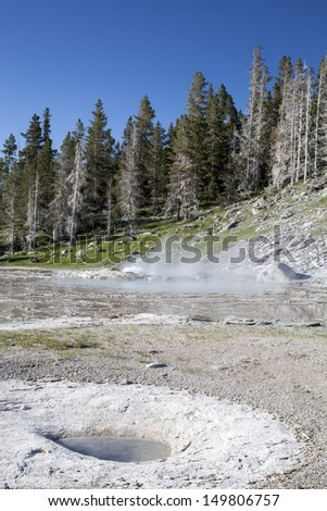 Grand geyser a few minutes before erupting, Yellowstone National Park, USA  - stock photo
