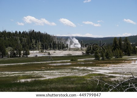 Grand Group Geyser eruption seen from far away, Upper Geyser Basin, Yellowstone National Park - stock photo