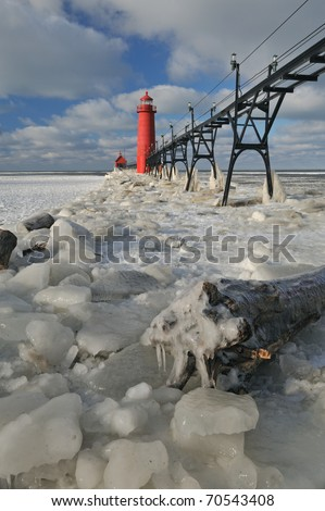 Grand Haven Lighthouse, Lake Michigan, winter, with iced pier and catwalk, Michigan, USA - stock photo