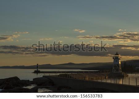 Grand Marais Lighthouse Sunset - stock photo