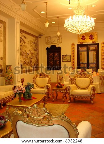 Grand oriental mansion's living room with antique furniture - stock photo