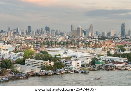 Grand Palace along the Chaophraya river at dusk, Bangkok, Thailand - stock photo