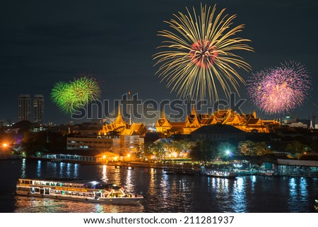 Grand palace and cruise ship in night with fireworks - stock photo