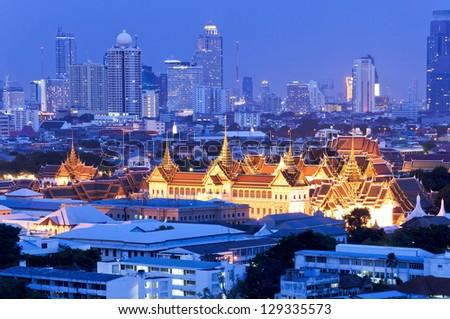 Grand Palace and Emerald Buddha Temple (Wat Phra Kaew) at twilight - stock photo