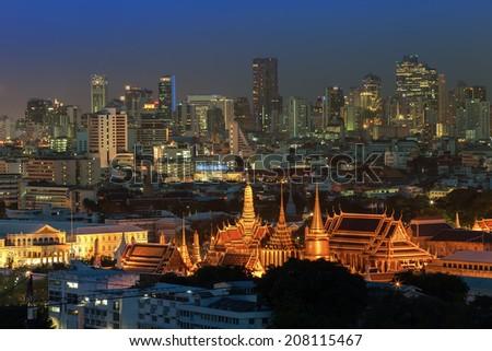 Grand palace at twilight with Bangkok city background (Thailand) - stock photo