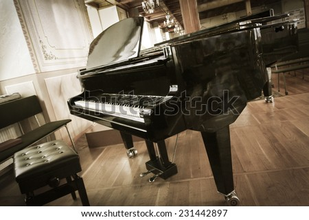 Grand-piano with a chair in the hall  - stock photo