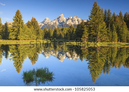 Grand Teton Peaks with water reflections - stock photo