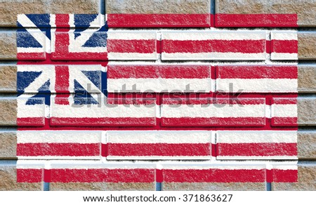 Grand Union flag painted on old brick wall texture background - stock photo