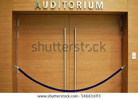 Grand wooden auditorium entrance. For various business and lifestyle concepts. - stock photo