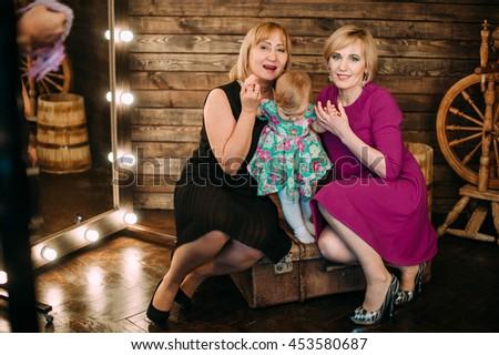 Grandchildren and grandparents in living room - stock photo
