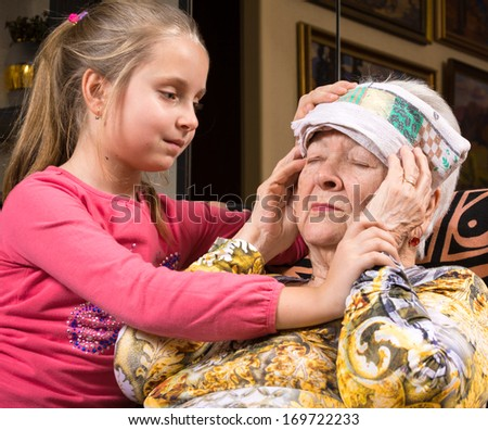 Granddaughter caring about ill grandmother - stock photo