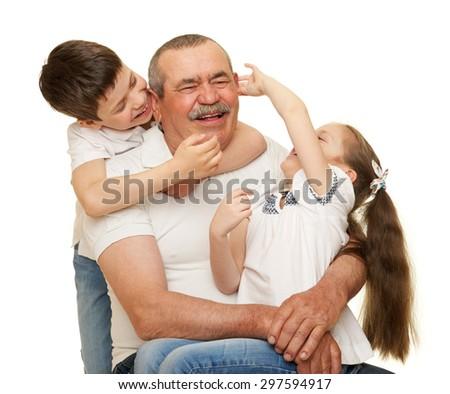 Grandfather and grandchildren portrait on white - stock photo