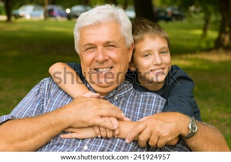 Grandfather and grandson - stock photo