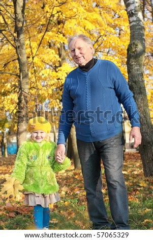 grandfather and little girl outdoor - stock photo