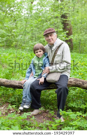 grandfather and small grandson in spring Park - stock photo