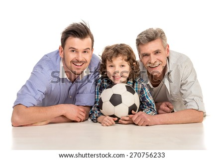 Grandfather, father and son lying and looking at camera, isolated a white background. - stock photo