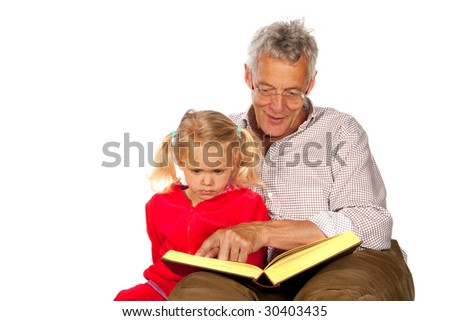 Grandfather is telling a exciting story to his grandchild - stock photo