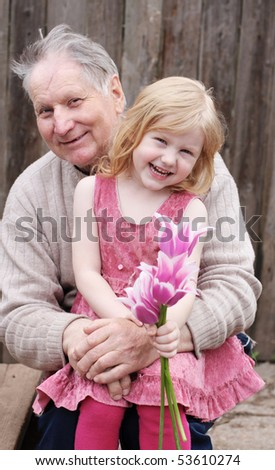 grandfather with girl outdoor - stock photo