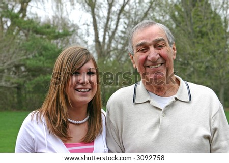 Grandfather with granddaughter - stock photo