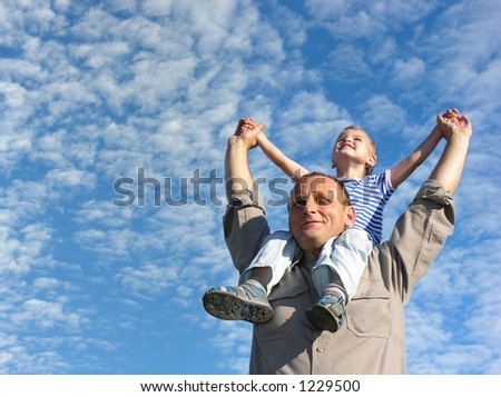 grandfather with grandson under cloudfield - stock photo